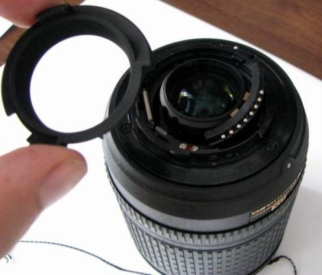 Изучение упрощенной оптической схемы объектива на сайте никона естественно ничего не дала.